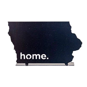 "A steel flange decorative piece in the shape of Iowa with a laser cut out of the word ""home."""